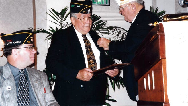 George Offitt, center, receives recognition at an American Legion convention. Offitt was a member of Gallatin's American Legion Post 17.