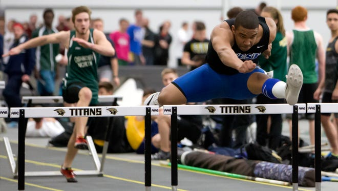DeShawn Dickinson of Oshkosh West clears the hurdle in the 60 meter of the Oshkosh North School Invitational at the Kolf Sports Center on Tuesday, March 15, 2016.