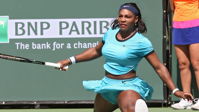 Serena Williams slips and does the splits during her loss to Victoria Azarenka at the BNP Paribas Open in Indian Wells, March 20, 2016.
