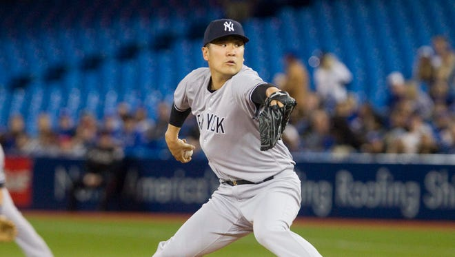 New York Yankees starting pitcher Masahiro Tanaka throws against the Toronto Blue Jays during the first inning of a baseball game Tuesday, April 12, 2016, in Toronto.