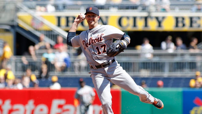 521172480.jpg PITTSBURGH, PA - APRIL 14:  Andrew Romine #17 of the Detroit Tigers fields a ball for an out in the fourth inning during inter-league play against the Pittsburgh Pirates at PNC Park on April 14, 2016 in Pittsburgh, Pennsylvania.