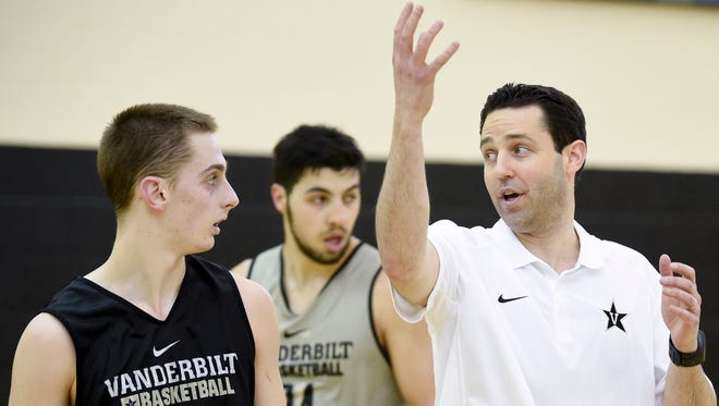 Vanderbilt Commodores coach Bryce Drew speaks with Riley LaChance (13) during practice at Vanderbilt University on April 14, 2016.