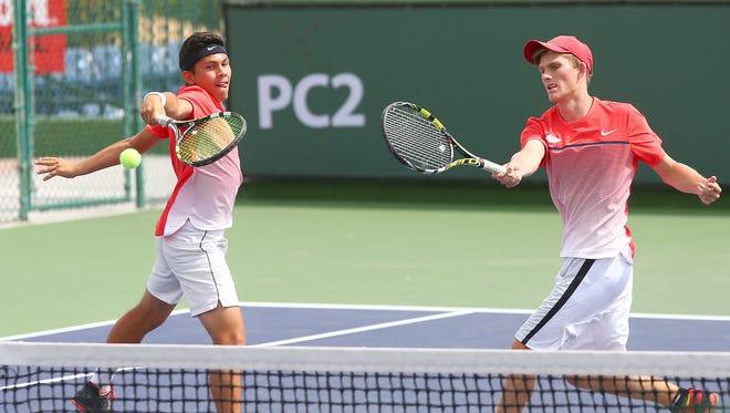 Sebastian Gomez and Bradley Cummins return a shot during their DVL doubles tennis finals win in Indian Wells, April 26, 2016.