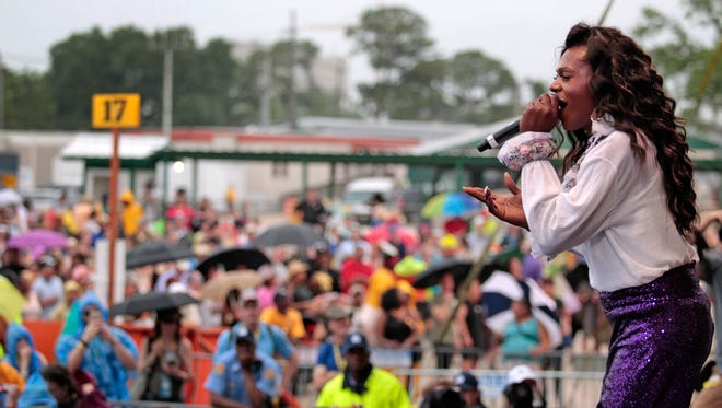 Big Freedia performed to a large crowd on the Congo Square Stage, despite the rain, during day 6 of Jazz Fest at the Fair Grounds in New Orleans on Saturday.