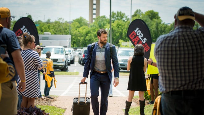 Predators captain Shea Weber arrives at Signature Flight Support on Friday before boarding a plane to depart for San Jose, site of Game 5 of their playoff series with the Sharks.