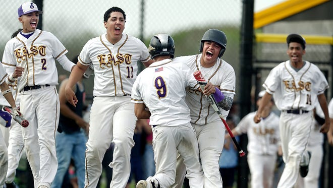 East High's Darnell Patterson (9) is mobbed by teammates after his inside the park homerun during the RCAC Championship game played at Monroe Community College on May 12, 2016. Facing from left are: Jordi Agosto, Xavier Colon, Eric Maldonado and Jorge Hernandez.