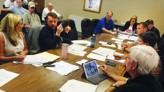 Sumner County Finance Director David Lawing (left in black) speaks during the Budget Committee meeting on Monday, June 13, 2016 in Gallatin.