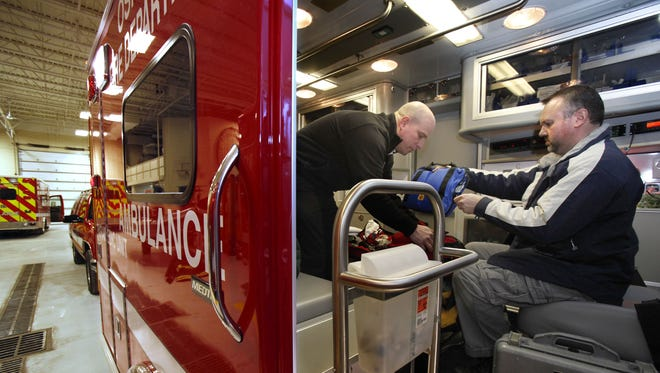 Paul Schilling (right) a state ambulance inspector, performs an ambulance inspection with Battalion Chief Jim Austad at the Oshkosh Fire Department on Jan. 22.