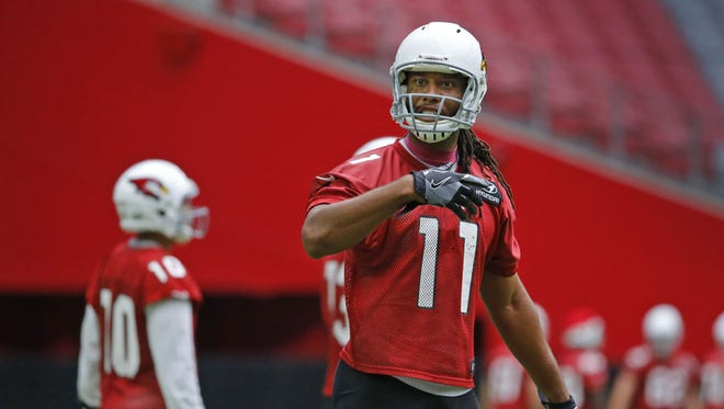 Arizona Cardinals wide receiver Larry Fitzgerald (11) fires up the crowd during training camp Saturday, July 30, 2016 in  Glendale, Ariz.