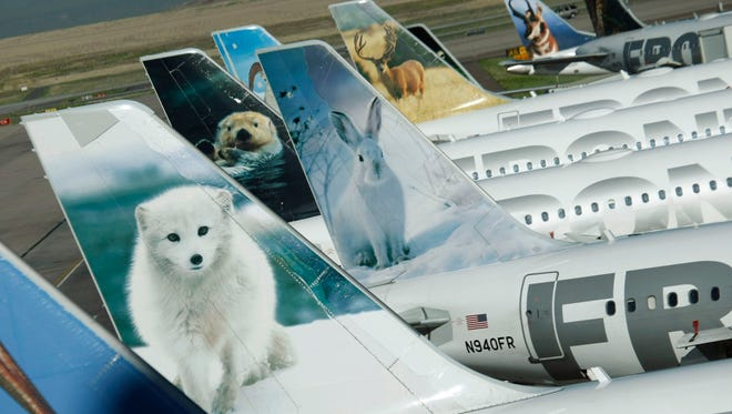 Frontier Airlines planes at Denver International Airport.
