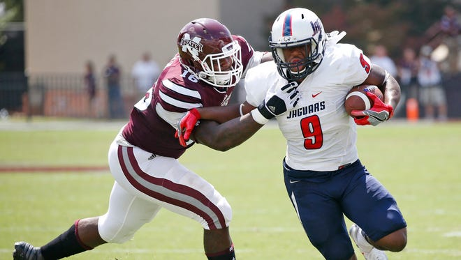 Mississippi State defensive lineman Johnathan Calvin, tries to tackle South Alabama running back Tyreis Thomas (9) in the first half of an NCAA college football game in Starkville, Miss., Saturday, Sept. 3, 2016. (AP Photo/Rogelio V. Solis)