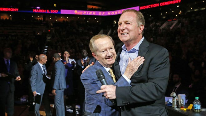 Phoenix Suns announcer  Al McCoy is honored by Suns Owner Robert Sarver during a break in action during their home opener against the Sacramento Kings Wednesday, Oct. 26, 2016 in Phoenix, Ariz.