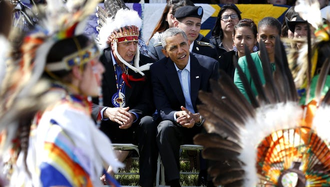 President Barack Obama and Chairman of the Standing Rock Sioux Tribe David Archambault II, left, watch dancers during a visit to the Standing Rock Indian Reservation in Cannon Ball, N.D., in June 2014.