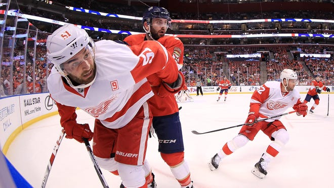 Frans Nielsen of the Detroit Red Wings and Keith Yandle of the Florida Panthers.