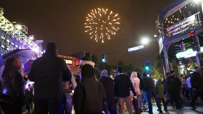 Fireworks shoot off A Mounatin during the Circle K New Year's Eve Block Party in Tempe December 31, 2014.