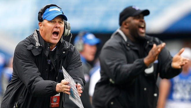 December 30, 2015 - Memphis interim head coach Darrell Dickey (left) and Director of High School Relations Marcus Bell (right) cheer on the players during second quarter action against Auburn in the Birmingham Bowl at Legion Field in Birmingham, Ala.