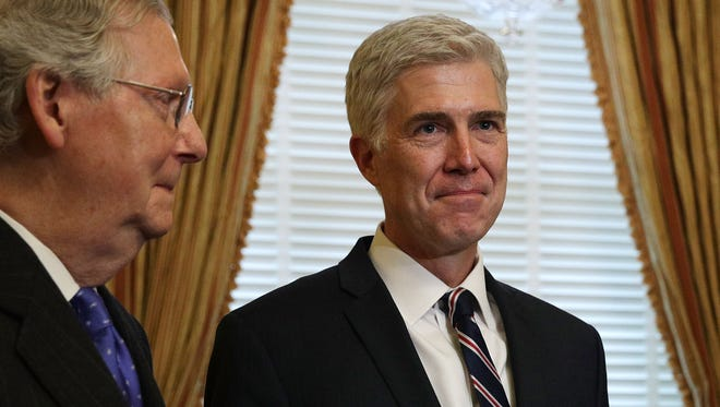 Senate Majority Leader Sen. Mitch McConnell, R-Ky., left, meets with Supreme Court nominee Judge Neil Gorsuch on Feb. 1, 2017, at the U.S. Capitol.