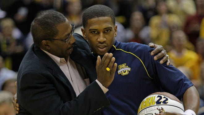 George Thompson (left) congratulates Marquette's all-time leading scorer Jerel McNeal before a game at the Bradley Center on Feb. 14, 2009.