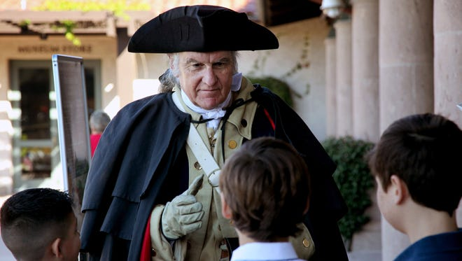 C. Roger Cooper, portraying President George Washington, greets young visitors during Presidents Day celebrations at the Reagan Presidential Library in Simi Valley, Calif.