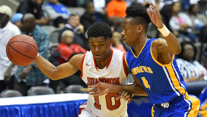 Shannon's Jacciren DIlworth (10) drives against Raymond's Tavian Coleman (4) during MHSAA 4A Boys quarterfinal action held Friday March 6th, 2017 at the Mississippi Coliseum in Jackson, MS.