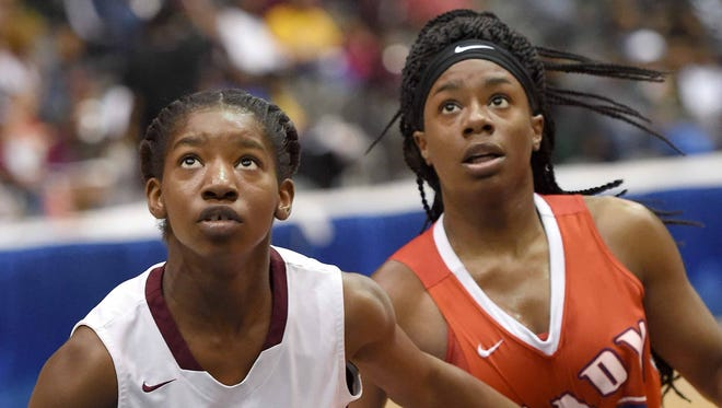 Lanier's Jazmine Hobson (15) blocks out Neshoba's Andria Carter (32) for a rebound on Tuesday, March 7, 2017, in the MHSAA C Spire State Basketball Tournament semifinals at the Mississippi Coliseum in Jackson, Miss.
