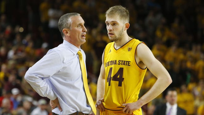 Arizona State Sun Devils head coach Bobby Hurley talks with Kodi Justice during the second half of their NCAA basketball game Saturday, March 4, 2017 in Tempe.
