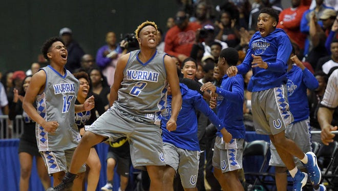 The Murrah Mustangs celebrate their overtime victory beating Brandon 69-66 on Wednesday in the class 6A semifinals in Mississippi Coliseum.