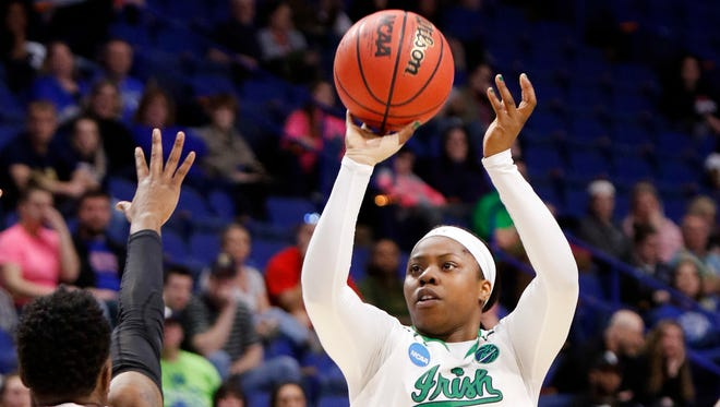 Notre Dame's Arike Ogunbowale (24) shoots while defended by Ohio State's Shayla Cooper (32) during a regional semifinal in the women's NCAA college basketball tournament in Lexington, Ky., Friday, March 24, 2017.
