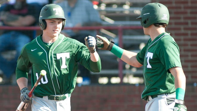 Trinity's Matthew Higgins gets congratulated after scoring on a fielder's choice hit by Trinity's Brandon Pfaadt in the top of the 1st inning.11 April 2017