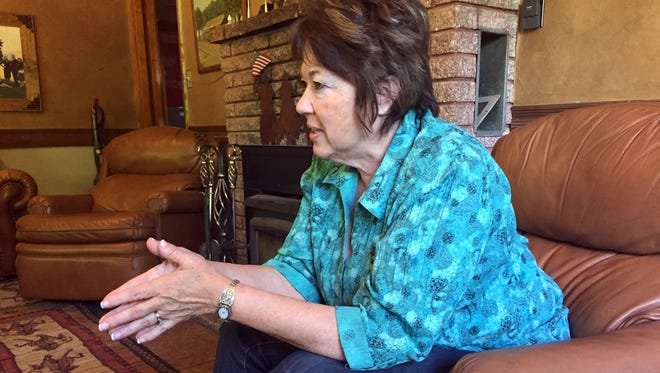 Carol Bundy sits in the living room of the Bundy family ranch in Bunkerville, Nev., about 70 miles of northeast of Las Vegas.