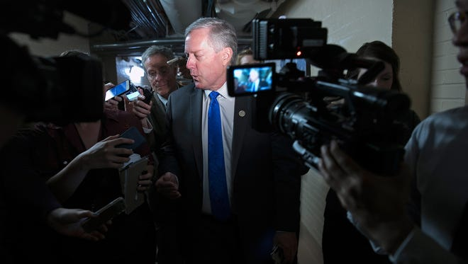 Rep. Mark Meadows, R-N.C., chairman of the House Freedom Caucus, answers questions while leaving a meeting at the U.S. Capitol on April 26, 2017.