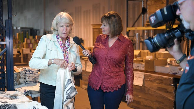"NewsChannel 5's Meryll Rose and The Tennessean's Mary Hance tape a story for ""Talk of the Town"" at Hester & Cook. Rose's friend and longtime colleague Mike Radford works the camera. Five years ago, Rose had a brain aneurysm that almost killed her and took her off the air for six months. Hance and Radford were there the day it happened."