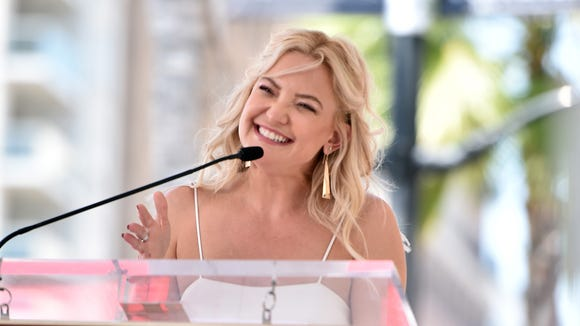 Proud daughter: Kate Hudson spoke onstage.