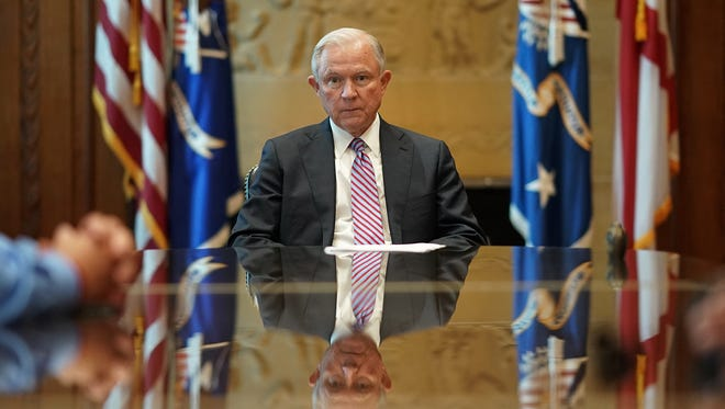 Sessions meets with families of victims killed by illegal immigrants in his office at the Justice Department on June 29, 2017, in Washington.
