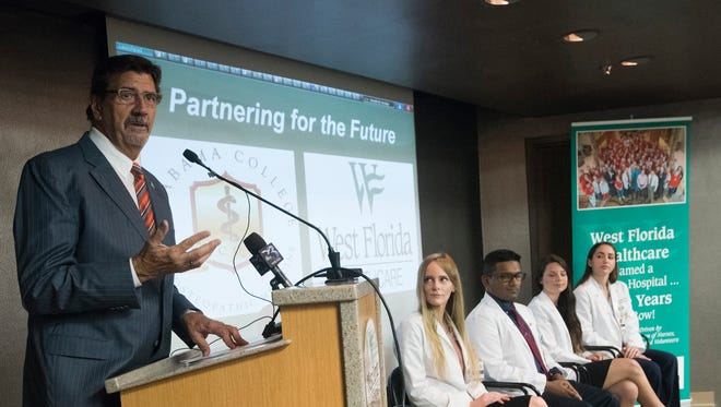 Craig Lenz, dean and senior vice president of the Alabama College of Osteopathic Medicine, announces a new partnership with West Florida Healthcare to provide clinical training to third- and fourth-year medical students during a press conference at the hospital on Tuesday, July 25, 2017.