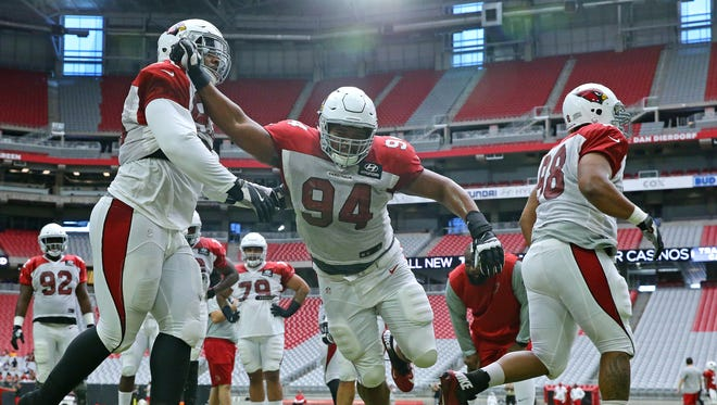 Arizona Cardinals nose tackle Xavier Williams (94) burst through the line during training camp Tuesday, Aug. 15, 2017, in Glendale, Ariz.