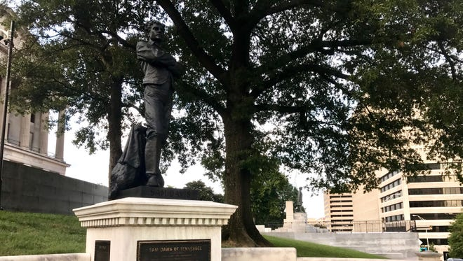 A statue of Confederate scout Sam Davis stands outside the Tennessee State Capitol in Nashville.