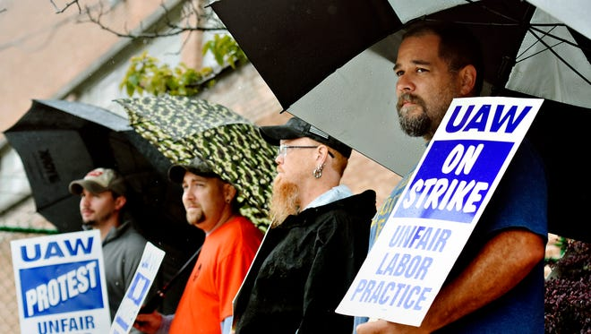 In hope of gaining a new contract, from front, Jeremiah Arevalo, of Dover,  Lance Pickering, of Gettysburg, Elijah Zeigler, of York Township, and UAW Vice President Jared Byerts stand outside the Grantley Road entrance to Johnson Controls in Spring Garden Township, Tuesday, Aug. 29, 2017. Dawn J. Sagert photo