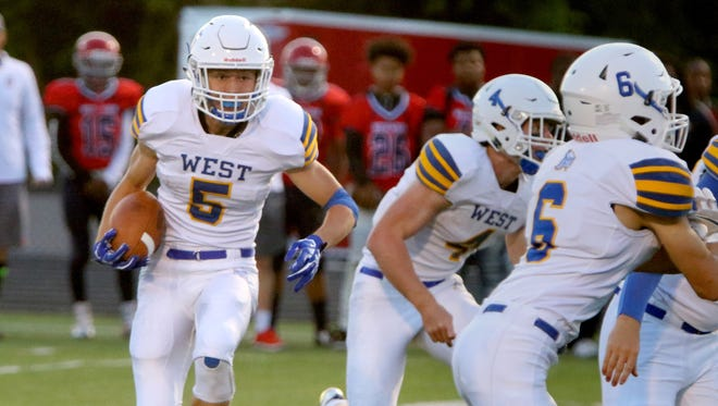 New Berlin West's Tyler Stolenberg rolls out of the backkfield at Shorewood on Sept. 1