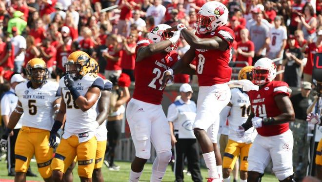 Lamar Jackson and Malik Williams celebrate after Williams scored in the first half.