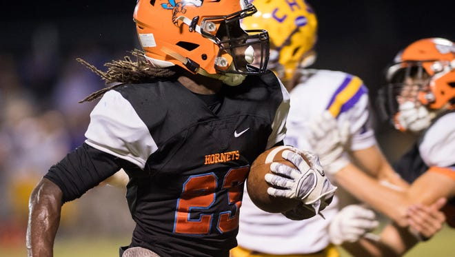 South Gibson's Dre McAllister sprints toward the end zone to score South Gibson's first touch down of the night on Friday, October 13, 2017, during Covington's 48-21 victory over South Gibson at South Gibson County High School.