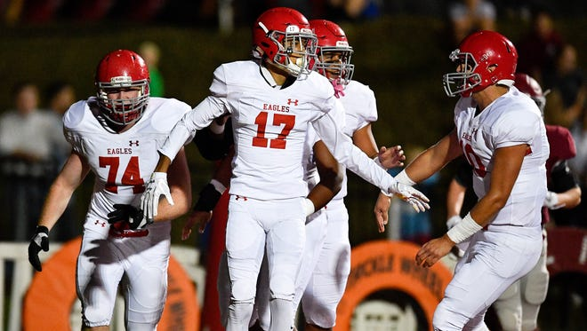 Brentwood Academy's Michael Archie (17) celebrates his touchdown against MBA during the first half at Montgomery Bell Academy in Nashville, Tenn., Friday, Oct. 20, 2017.