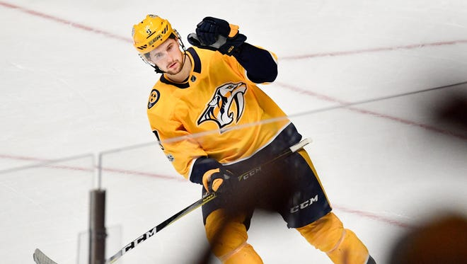 Nashville Predators left wing Filip Forsberg (9) reacts to scoring against the Calgary Flames during the shootout at Bridgestone Arena in Nashville, Tenn., Tuesday, Oct. 24, 2017.