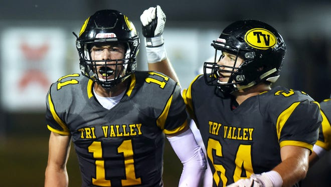 Tri-Valley's Jake McLoughlin celebrates with teammate Garrett French after making a catch in the third quarter against Philo.