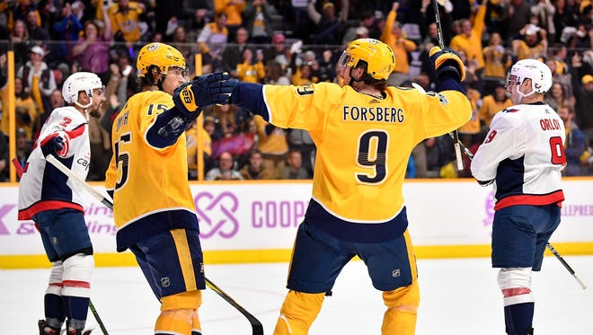 Nashville Predators right wing Craig Smith (15) celebrates his goal against the Washington Capitals with left wing Filip Forsberg (9) during the first period at Bridgestone Arena in Nashville, Tenn., Tuesday, Nov. 14, 2017.
