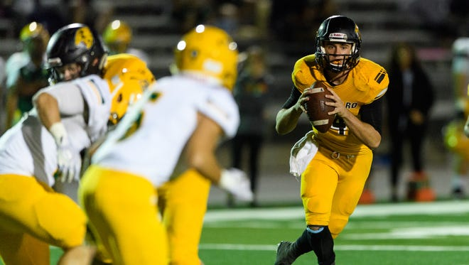 Saguaro's Max Massingale (#4) scrambles out of the pocket in the third quarter of their high school football game against Peoria on Friday, Nov. 10, 2017, at Saguaro High School in Scottsdale, Ariz.