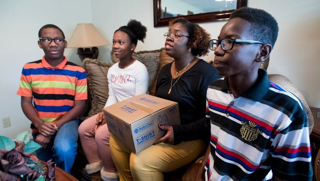 The Jiles family, from left, Joshua, Victoria, Denise and Gregory discuss their experience with the backpack food bag program at the Jiles home in Montgomery, Ala. on Tuesday November 21, 2017.