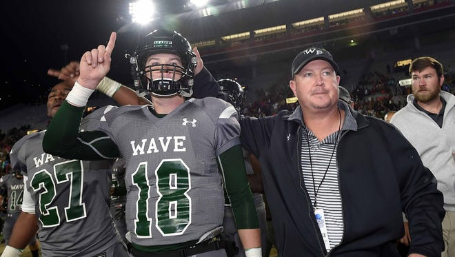 West Point Green Wave head coach Chris Chambless (right) walks to midfield after the MHSAA Football State Championships with his son Jake Chambless (18) after beating Hattiesburg 41-15 on Saturday, December 2, 2017. West Point will play for its third-straight state championship this weekend.