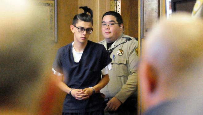 n this Aug. 31, 2017, file photo, Nathaniel Jouett, who would later plead guilty to fatally shooting two workers inside a public library and wounding four others, enters a courtroom in Clovis, N.M.