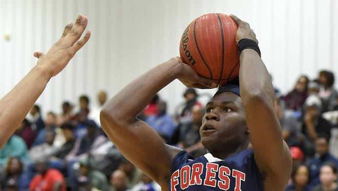 Forest Hill's Ladarius Marshall (23) shoots from the corner against Columbus during a Rumble in the South MLK Classic high school basketball tournament game on Monday, January 15, 2018, at St. Andrew's Episcopal School in Ridgeland, Miss.